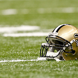 January 7, 2012; New Orleans, LA, USA; A detailed view of a New Orleans Saints helmet  and gatorade bottle on the field before the 2011 NFC wild card playoff game against the Detroit Lions at the Mercedes-Benz Superdome. Mandatory Credit: Derick E. Hingle-US PRESSWIRE