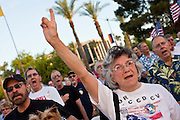 15 APRIL 2011 - PHOENIX, AZ: Tea Party supporters at a Tea Party rally in Phoenix Friday. About 500 supporters of the Tea Party movement rallied Friday at the Arizona State Capitol to mark tax day. They protested high taxes, the federal deficit, the debt limit and immigration policy. About 50 pro-immigrant protesters held a counter rally at the capitol. At least one person was arrested, and others led away by police after several shouting matches between Tea Party supporters and the immigrants rights protesters broke out.     Photo by Jack Kurtz