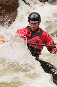 Michael Bundy kayaks in the whitewater of the Narrows on the Poudre River, Colo., June 27, 2004.