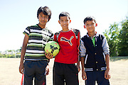 Roshan Biswa (13), Yogesh Acharya (13) and Roshan Diyali (13) play soccer across from their homes in the Ivy Apartments where Thomas E. Duncan, the first confirmed Ebola virus patient in the United States, was staying with family in Dallas, Texas on October 4, 2014. Duncan is now being treated at Texas Health Presbyterian Hospital Dallas while members of his family have been isolated in the apartment. (Cooper Neill for The New York Times)
