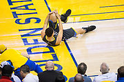 Golden State Warriors guard Klay Thompson (11) grabs his leg after falling during a lay up against the Houston Rockets during Game 4 of the Western Conference Finals at Oracle Arena in Oakland, Calif., on May 22, 2018. (Stan Olszewski/Special to S.F. Examiner)