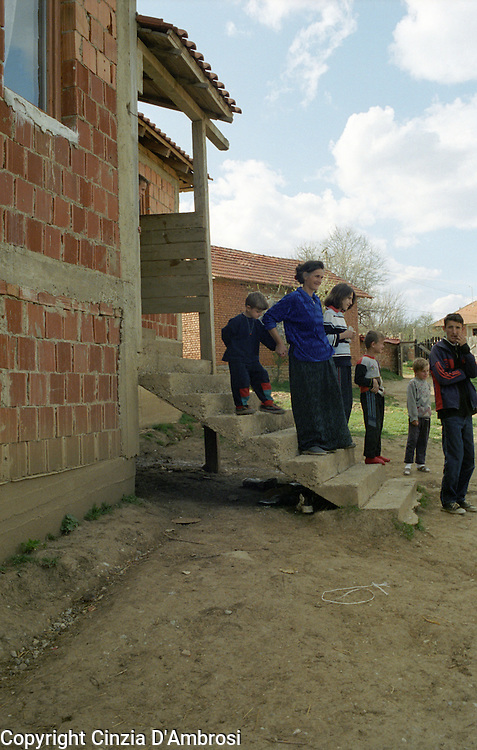 In Kosovo, some of the villages like Meje has no men left.  The widows with their children have a difficult life.  Their homes are mostly unfinished after Ngos were sent away from the country and their meagre support of 60Euros is meant to support the whole family for a month. A widow of Meje with 5 children.