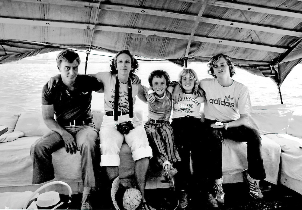 Tom, Jeanne, Robert, Isabel, and John Tifft, with two white mice, sit in a row for their portrait while sailing up the River Nile.