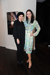 Left to right, CARMEN HAID and DANNII MINOGUE at a private view of Atelier-Mayer.com's collection held at 131 Oakwood Court, London, on 24th November 2009.