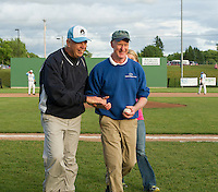 Bob Glassett and Larry Greeley of Lakes Region Home Builders leave Robbie Mills field after Greeley threw out the first pitch of the Muskrats game with New Bedford Wednesday evening.   (Karen Bobotas/for the Laconia Daily Sun)