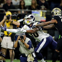 Nov 4, 2018; New Orleans, LA, USA; Los Angeles Rams running back Todd Gurley (30) reaches for a pass as New Orleans Saints cornerback P.J. Williams (26) defends during the third quarter at the Mercedes-Benz Superdome. Mandatory Credit: Derick E. Hingle-USA TODAY Sports