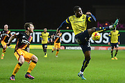 Oxford United defender Cheyenne Dunkley (33) misses clearance watched by Bradford City striker Billy Clarke (10) 0-0 during the EFL Trophy match between Oxford United and Bradford City at the Kassam Stadium, Oxford, England on 31 January 2017. Photo by Alan Franklin.