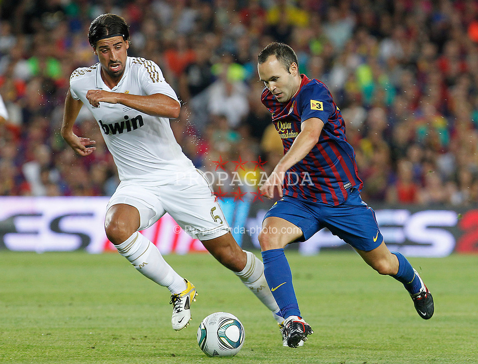 17.08.2011, Camp Nou, Barcelona, ESP, Supercup 2011, FC Barcelona vs Real Madrid, im Bild FC Barcelona's Andres Iniesta (r) and Real Madrid's Sami Khedira during Spanish Supercup 2nd match.August 17,2011. EXPA Pictures © 2011, PhotoCredit: EXPA/ Alterphotos/ Acero +++++ ATTENTION - OUT OF SPAIN / ESP +++++