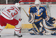 3/11/05 Omaha, Neb.University of  Nebraska at Omaha's Scott Parse first a shot at Lake Superior State goalie Jeff Jakaitis in the first period Saturday night in Qwest Center Omaha. This was the first gamein the CCHA play-off.(photo by chris machian/Prarie Pixel Group)