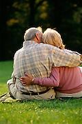 senior couple hugging, rear view
