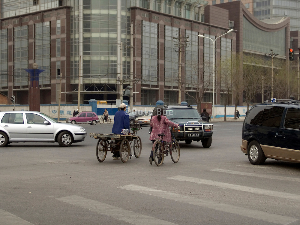bicycle cart waiting to cross a road Beijing China