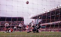 Rory Delap shoots over Arsenal goalkeeper John Lukic but onto the cross-bar. Arsenal 0:0 Derby County, F.A.Carling Premiership, 11/11/2000. Credit / Colorsport / Michael Bury.