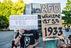 "June 19, 2017 - Munich, Germany - Two youth protestors. The far- to radical-right and populist AfD party and speaker Wolfgang Wiehle held a rally at Munich's Schweizer Platz, which drew approximately 75 supporters, many from the Pegida-Munich circles, as well as several in neo-nazi circles. Approximately 50 peaceful counter-demonstrators organized by the SPD party and Muenchen ist Bunt group were also in attendance.  Only one altercation arose when a member of the public and NOT part of the demonstrators approached the stage and created a minor disturbance.  The theme of the speech was ""Buerger an der Macht"" (""Power to the People"") and Schweizer Platz was chosen as a tie-in to the AfD's concept of using the Swiss example to handle immigration and foreigners. (Credit Image: © Sachelle Babbar via ZUMA Wire)"