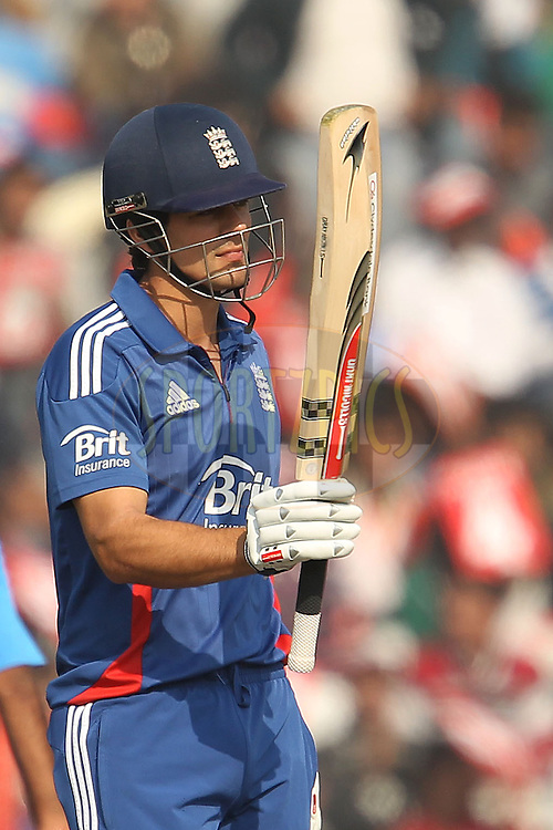 Alastair Cook of England raises his bat as he reaches fifty during the 4th Airtel ODI Match between India and England held at the PCA Stadium, Mohal, India on the 23rd January 2013..Photo by Ron Gaunt/BCCI/SPORTZPICS ..Use of this image is subject to the terms and conditions as outlined by the BCCI. These terms can be found by following this link:..http://www.sportzpics.co.za/image/I0000SoRagM2cIEc