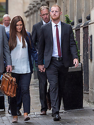 © Licensed to London News Pictures. 08/08/2018. Bristol, UK. England cricketer BEN STOKES and his wife CLARE RATCLIFFE walk to Bristol Crown court for the third day of his trial on charges of affray that relate to a fight outside a Bristol nightclub on September 25 2017. Stokes and two other men, Ryan Ali, 28, and Ryan Hale, 27, all deny the charge. Stokes, Ali and Hale are jointly charged with affray in the Clifton Triangle area of Bristol on September 25 last year, several hours after England had played a one-day international against the West Indies in the city. A 27-year-old man allegedly suffered a fractured eye socket in the incident. Photo credit: Simon Chapman/LNP