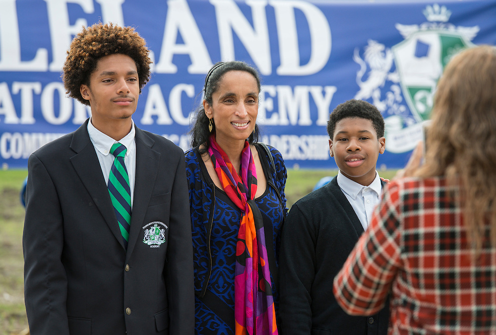 Alison Leland poses for a photograph with students during groundbreaking ceremonies for the Mickey Leland College Preparatory Academy, April 16, 2015.