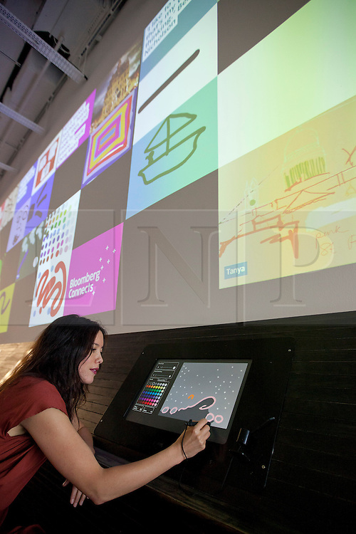© Licensed to London News Pictures. 19/09/2013. London, UK. Artist Gail Chong Kwan uses a touch screen to draw art at the press launch of 'Make Your Mark on Tate Modern' at the gallery in London today (19/09/2013). The new interactive feature allows artists and members of the public to create art and then post it to the on one of the 75 display screens, the created art is then archived by the gallery. Photo credit: Matt Cetti-Roberts/LNP
