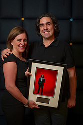 © Licensed to London News Pictures. 04/112/2013. London, UK.  Stand-up comedian Micky Flanagan is presented with a commemorative plaque by General Manager of The O2 Arena Rebecca Kane after selling out seven tour dates at the venue, performing to over 100,000 fans. Photo credit : David Fearn/LNP