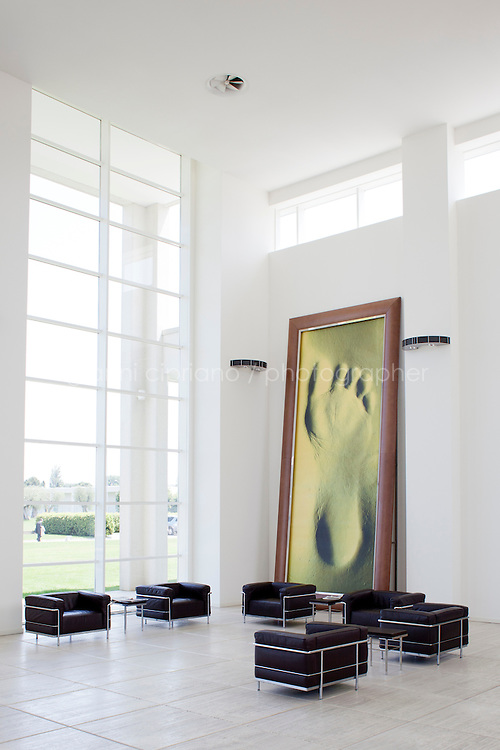 SANT'ELPIDIO A MARE, ITALY - MAY 20: Entrance hall of the Tod's headquarters with giant foot photograph of Italian photographer Giovanni Castel in Sant'Elpidio a Mare (FM, Marche), Italy, on May 20, 2011. The Tod's headquarters was designed by Della Valle's wife Barbara Pistilli and was inaugurated in 1998. Tod's Group is an Italian company which produces shoes and other leather goods, and is presided over by businessman Diego Della Valle. It is most famous for its driving shoes.<br /> <br /> Gianni Cipriano for Le Monde