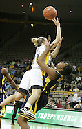08 February 2007: Iowa guard Kristi Smith (11) drives over Michigan center/forward Ta'Shia Walker (44) in Iowa's 66-49 win over Michigan at Carver-Hawkeye Arena in Iowa City, Iowa on February 8, 2007.