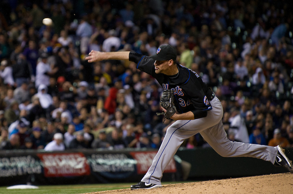NY Mets starter Mike Pelfrey, delivers against the Rockies at Coors Field