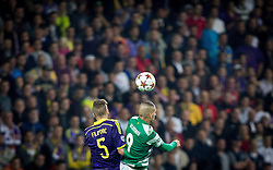 Zeljko Filipovic of Maribor vs Islam Slimani of Sporting during football match between NK Maribor and Sporting Lisbon (POR) in Group G of Group Stage of UEFA Champions League 2014/15, on September 17, 2014 in Stadium Ljudski vrt, Maribor, Slovenia. Photo by Vid Ponikvar  / Sportida.com