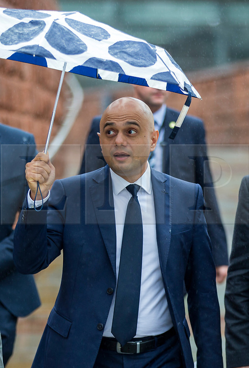 © Licensed to London News Pictures. 29/09/2019. Manchester, UK. Chancellor of the Exchequer Sajid Javid walks through the rain on first day of the Conservative Party Conference at Manchester Central in Manchester. Photo credit: Andrew McCaren/LNP
