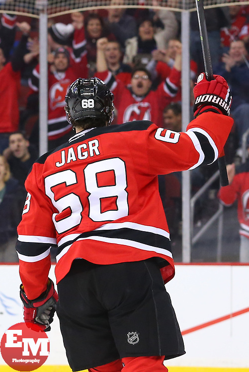 Mar 31, 2014; Newark, NJ, USA; New Jersey Devils right wing Jaromir Jagr (68) celebrates his goal during the first period at Prudential Center.