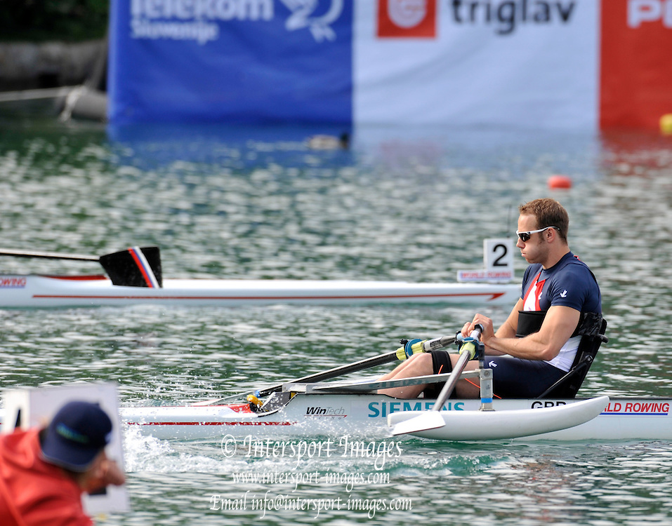 Bled, SLOVENIA,   Adaptive Rowing, ASM1X, Andy HOUGHTON, moves  away from the start, in his semi final on the second day, FISA World Cup , Bled held on Lake Bled.  Saturday  29/05/2010  [Mandatory Credit Peter Spurrier/ Intersport Images] Cop last event as international level. .  Adaptive, Rowing.