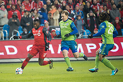 December 9, 2017 - Toronto, Ontario, Canada - Toronto FC forward JOZY ALTIDORE (17) dribbles the ball defended against Seattle Sounders defender CHAD MARSHALL (14) and Seattle Sounders defender ROMAN TORRES (29) during the MLS Cup championship match at BMO Field in Toronto, Canada.  Toronto FC defeats Seattle Sounders 2 to 0. (Credit Image: © Mark Smith via ZUMA Wire)