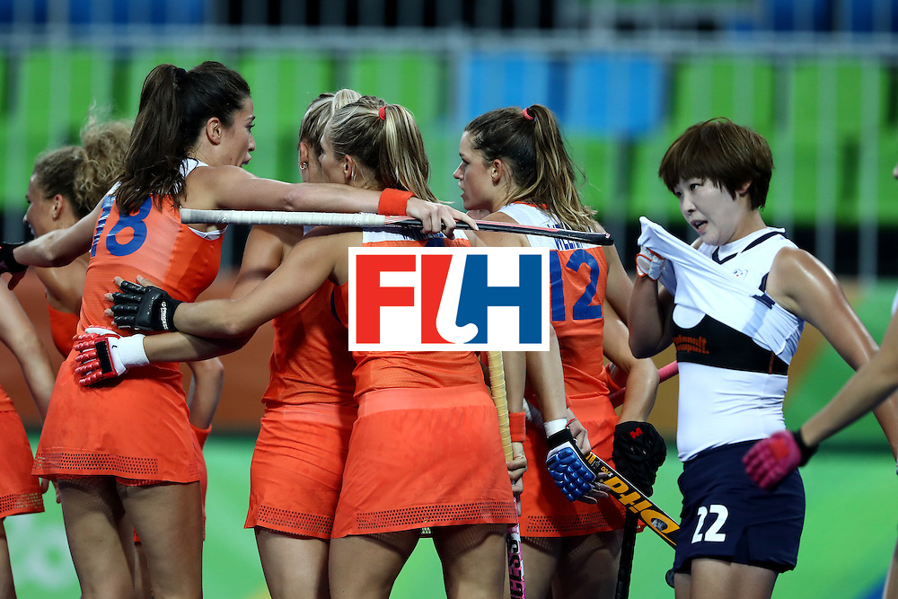 RIO DE JANEIRO, BRAZIL - AUGUST 08:  Kitty van Male #4, Naomi van As #18, and Lidewij Welten #12 of Netherlands celebrate a goal as Heesun Jang #22 of Korea looks on during a Women's Pool A match on Day 3 of the Rio 2016 Olympic Games at the Olympic Hockey Centre on August 8, 2016 in Rio de Janeiro, Brazil.  (Photo by Sean M. Haffey/Getty Images)