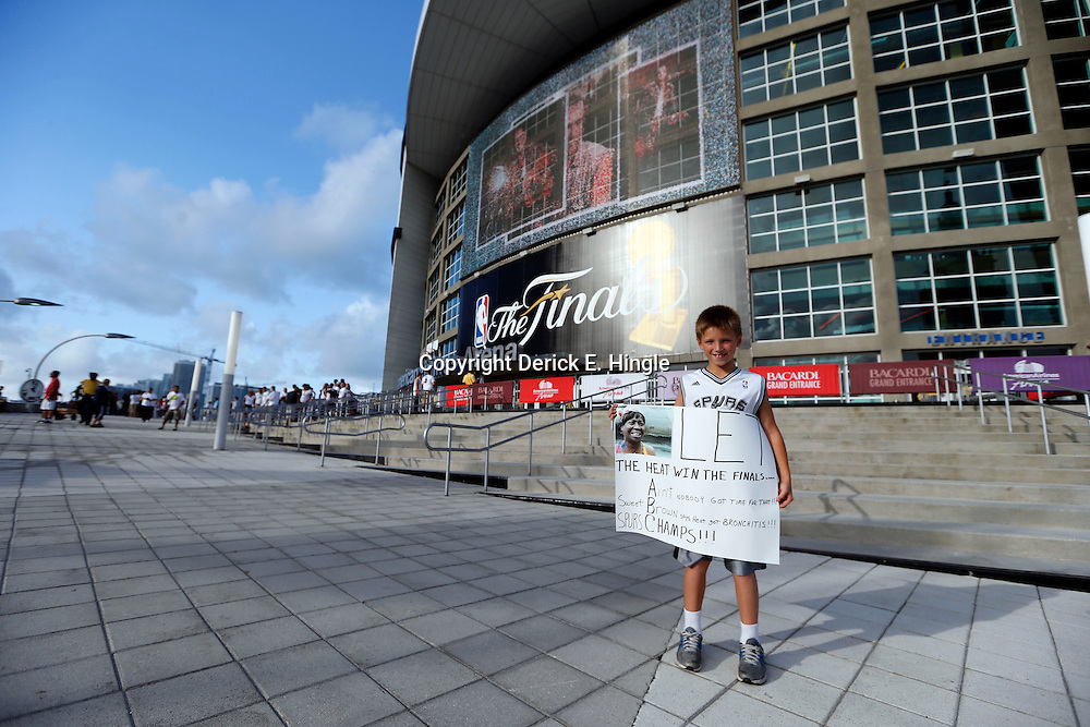 Jun 18, 2013; Miami, FL, USA; San Antonio Spurs fan Cade Duncan, age 9, waits outside prior to game six in the 2013 NBA Finals against the Miami Heat at American Airlines Arena.  Mandatory Credit: Derick E. Hingle-USA TODAY Sports