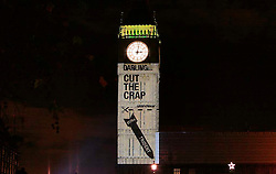 UK ENGLAND LONDON 8DEC09 - Greenpeace project a message onto Big Ben at the Houses of Parliament, Westminster, London...At approximately 3am, on the eve of the government's pre-budget report, Greenpeace added to the mounting calls to re-evaluate Trident replacement by sending a 100 foot high message to Chancellor Alistair Darling, projected onto Big Ben. The projection reads 'Darling….Cut the crap' with an image of a Trident missile with its £97 billion life-time price tag...jre/Photo by Jiri Rezac / Greenpeace