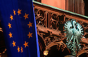 EU flag and Prussian eagle on Rathaus or Town hall in historic Romerberg Square, Frankfurt.