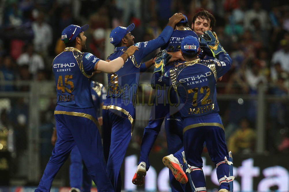 Mumbai Indians players celebrates the wicket of Sunrisers Hyderabad player Ravi Bopara during match 23 of the Pepsi IPL 2015 (Indian Premier League) between The Mumbai Indians and The Sunrisers Hyderabad held at the Wankhede Stadium in Mumbai India on the 25th April 2015.<br /> <br /> Photo by:  Vipin Pawar / SPORTZPICS / IPL