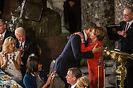 President Barack Obama hugs House Minority Leader Nancy Pelosi (D-CA) at the Inaugural Luncheon in Statuary Hall at the U.S. Capitol on Monday, January 21, 2013 in Washington, DC.