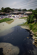 Black water probably dye enters the river from a factory,  environmental pollution on the river banks surrounding some of the textile industry buildings of Savar Upazila, a district of Dhaka, Bangladesh.  30th September 2018. The garment business is the main industry of Savar Upazila, a district in the northern part of Dhaka.  (photo by Andrew Aitchison / In pictures via Getty Images)