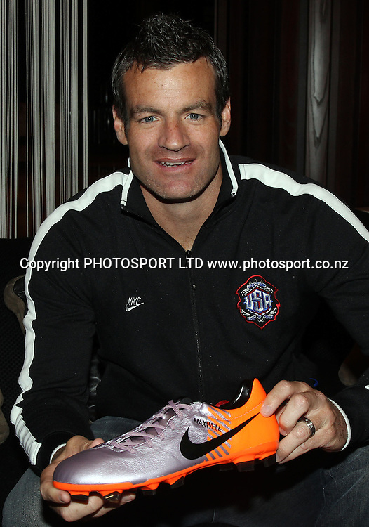 Ryan Nelsen with his personalised Nike boots.<br />The New Zealand All Whites football team sign merchandise during a signing session at Sky City in Auckland. 19 May 2010. Photo: Andrew Cornaga/PHOTOSPORT