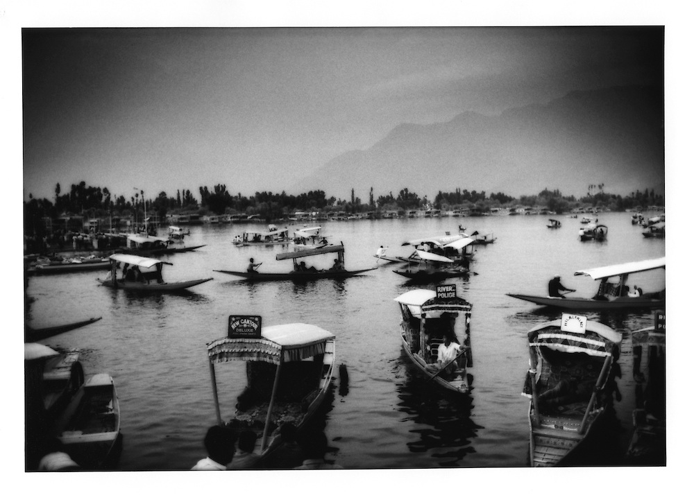 """""""Shakara"""" pleasure boat traffic jam as Hindu tourists have returned to Dal Lake, Srinagar, Indian Administered Kashmir.   Tourism is Kashmir's primary source of income.  Tourist industry numbers, particularly the number of foreign tourists,  have been a mere fraction of what they had been before the current trouble beginning in the 1990's."""
