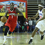 Maine Red Claws Guard Tyshawn Taylor (7) drives by Delaware 87ers Guard Josh Akognon (12) in the first half of a NBA D-league regular season basketball game between the Delaware 87ers (76ers) and the Maine Red Claws (Boston Celtics) Friday, March. 21, 2014 at The Bob Carpenter Sports Convocation Center in Newark, DEL