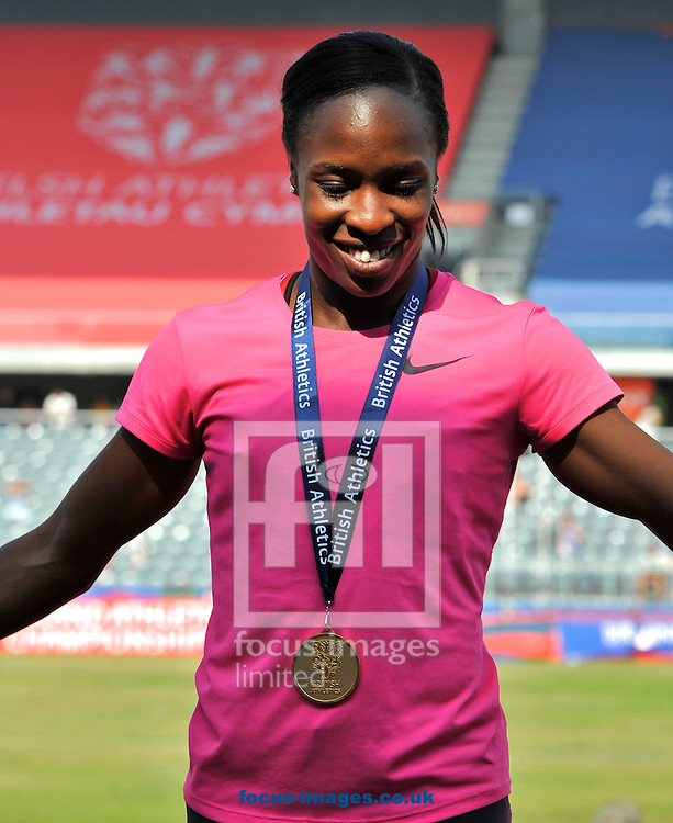 Picture by Alan Stanford/Focus Images Ltd +44 7915 056117<br /> 12/07/2013<br /> Marilyn Okoro (GBR) 800m pictured with her winners madal during day two of Sainsbury's British Championship at Alexander Stadium, Birmingham.
