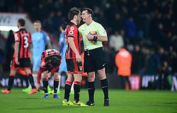 Referee Neil Swarbrick embraces Harry Arter of Bournemouth at full time. - Mandatory by-line: Alex James/JMP - 13/02/2017 - FOOTBALL - Vitality Stadium - Bournemouth, England - Bournemouth v Manchester City - Premier League