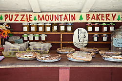 Puzzle Mountain Bakery, a small roadside stand selling homemade jams, breads, and pastries on the honor system, tempts passing motorists along a state highway in northwestern Maine.