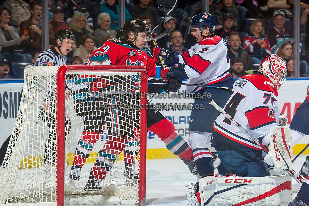 KELOWNA, CANADA - NOVEMBER 17: Kyle Topping #24 of the Kelowna Rockets is checked by Calen Addison #2 of the Lethbridge Hurricanes on November 17, 2017 at Prospera Place in Kelowna, British Columbia, Canada.  (Photo by Marissa Baecker/Shoot the Breeze)  *** Local Caption ***