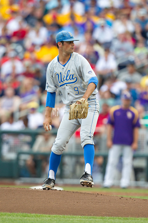 UCLA Bruins pitcher Adam Plutko #9 pitches during Game 4 of the 2013 Men's College World Series between the LSU Tigers and UCLA Bruins at TD Ameritrade Park on June 16, 2013 in Omaha, Nebraska. The Bruins defeated the Tigers 2-1. (Brace Hemmelgarn)