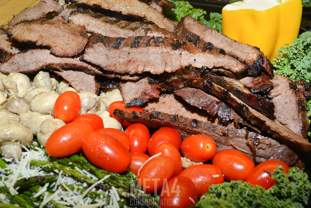 Freshly sliced steak served with tomatoes and a variety of colorful veggies!