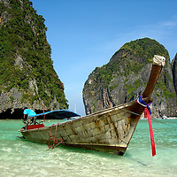 Minutes Before Tsunami on 12-26-2004 at Maya Bay in Phi Phi Islands, Thailand <br /> In the Leonardo DiCaprio movie, The Beach, college students seek paradise in the Phi Phi Islands of Thailand with disastrous results.  Four years later, my family had a similar experience within minutes of arriving in Maya Bay where the movie was filmed.  This was the last photo I took before we were nearly killed by the 2004 tsunami.  If you look closely, the water is retreating under this long-tailed boat.  Soon the water completely drained from the bay and a few minutes later a huge wave engulfed me and my two children. We nearly drowned. Read the full stories in the Adventures section.