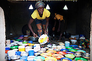 A cook is preparing the nutritional meals available under the School Feeding Program run by the local NGO SEND at the small rural institution that Hassana Ibrahim, 11, is attending, in Boggu, Tamale, northern Ghana.