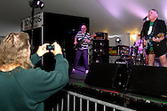 An audience member takes a picture as My Three Sons performs during the WTUE St. PatROCKS Party at Flanagan's Pub in Dayton, Saturday, March 17, 2012.
