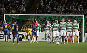 Xavi prepares to take a free kick as the Celtic wall lines up. Celtic v Barcelona, Uefa Champions League, Knockout phase, Celtic Park, Glasgow, Scotland. 20th February 2008.